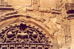 Deterioration of stone, missing spandrel stone