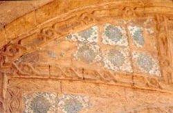 Missing colored ornamental ceramic tiles.Deteriorated stone profile.